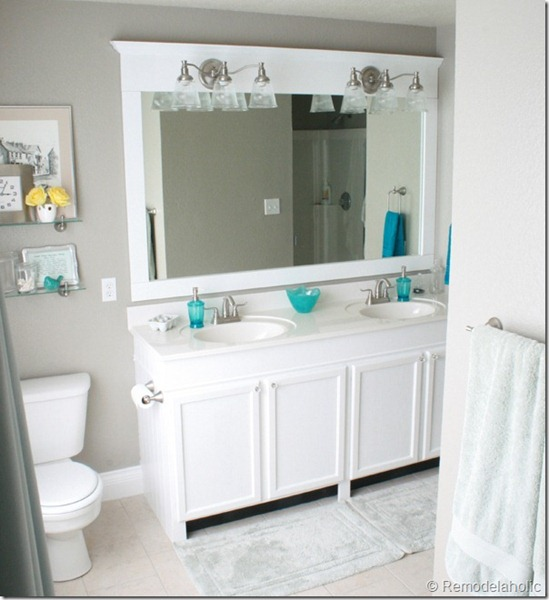 how to raise up a short vanity and frame a large bathroom mirror