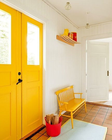 Brigth Yellow Door and bench in white entry room