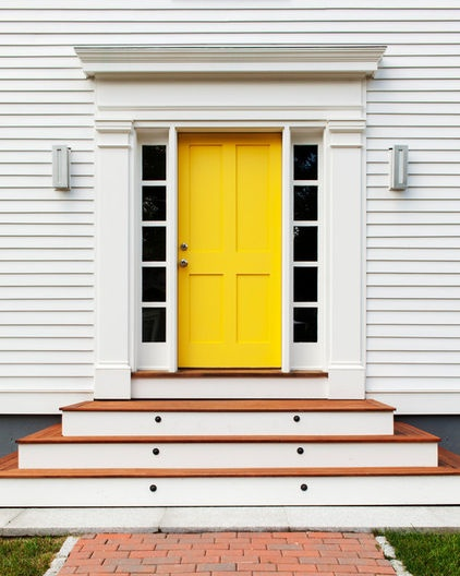 Yellow Entry door on white exterior