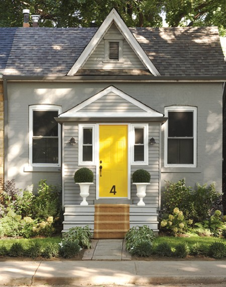 yellow entry door on grey exterior via canadian house and home