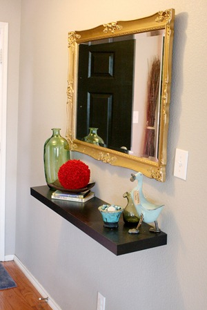 Entry updates black door white moldings entry table columns (17)