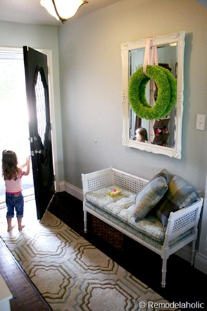 Entry updates black door white moldings entry table columns (19)