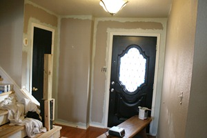 Entry updates black door white moldings entry table columns (26)