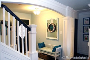 Entry updates black door white moldings entry table columns (27)