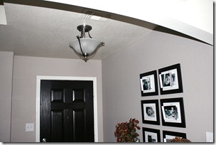 Entry updates black door white moldings entry table columns (7)