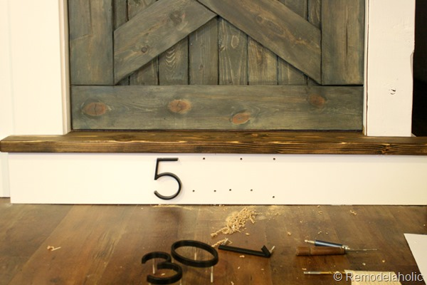 building out stair with wood bullnose and house numbers under barn door (14)