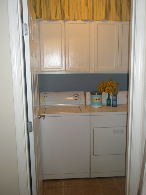 laundry room oak cabinet upgrade and organization