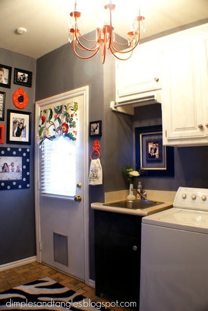 redecorated laundry room with organization and chandelier