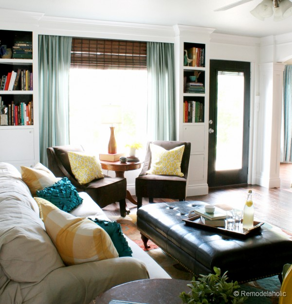 living room remodel with yellow accents wood floors and built in