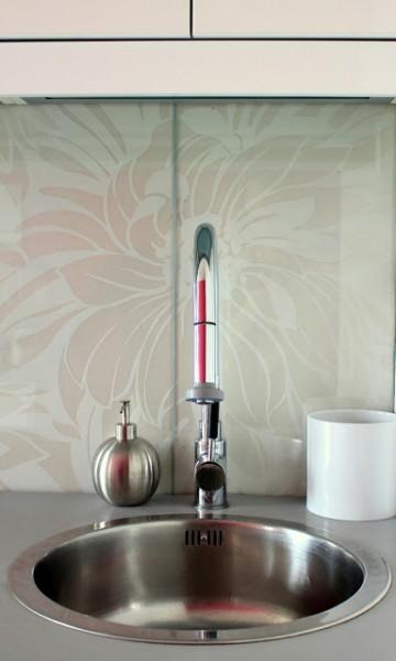 customized glass backsplash using shelving - Preciously Me on Ikea Hackers