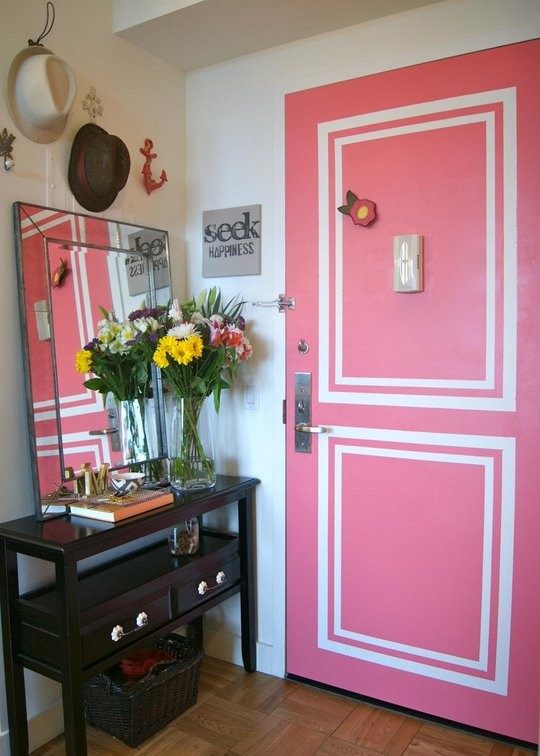 like this p ink door with faux painted moldings at heather elizabeth