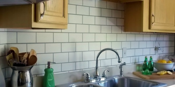 faux painted subway tile kitchen backsplash sink feature