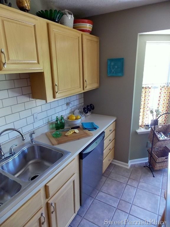 kitchen with faux painted subway tile backsplash