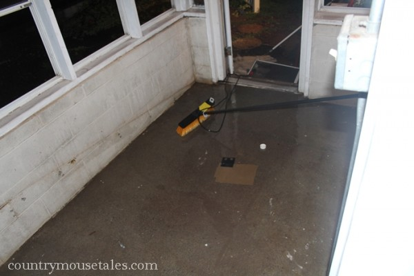 preparing a concrete floor for painting by scrubbing and etching