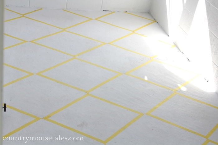 http://www.remodelaholic.com/wp-content/uploads/2013/06/tape-design-to-paint-a-concrete-mudroom-floor.jpg