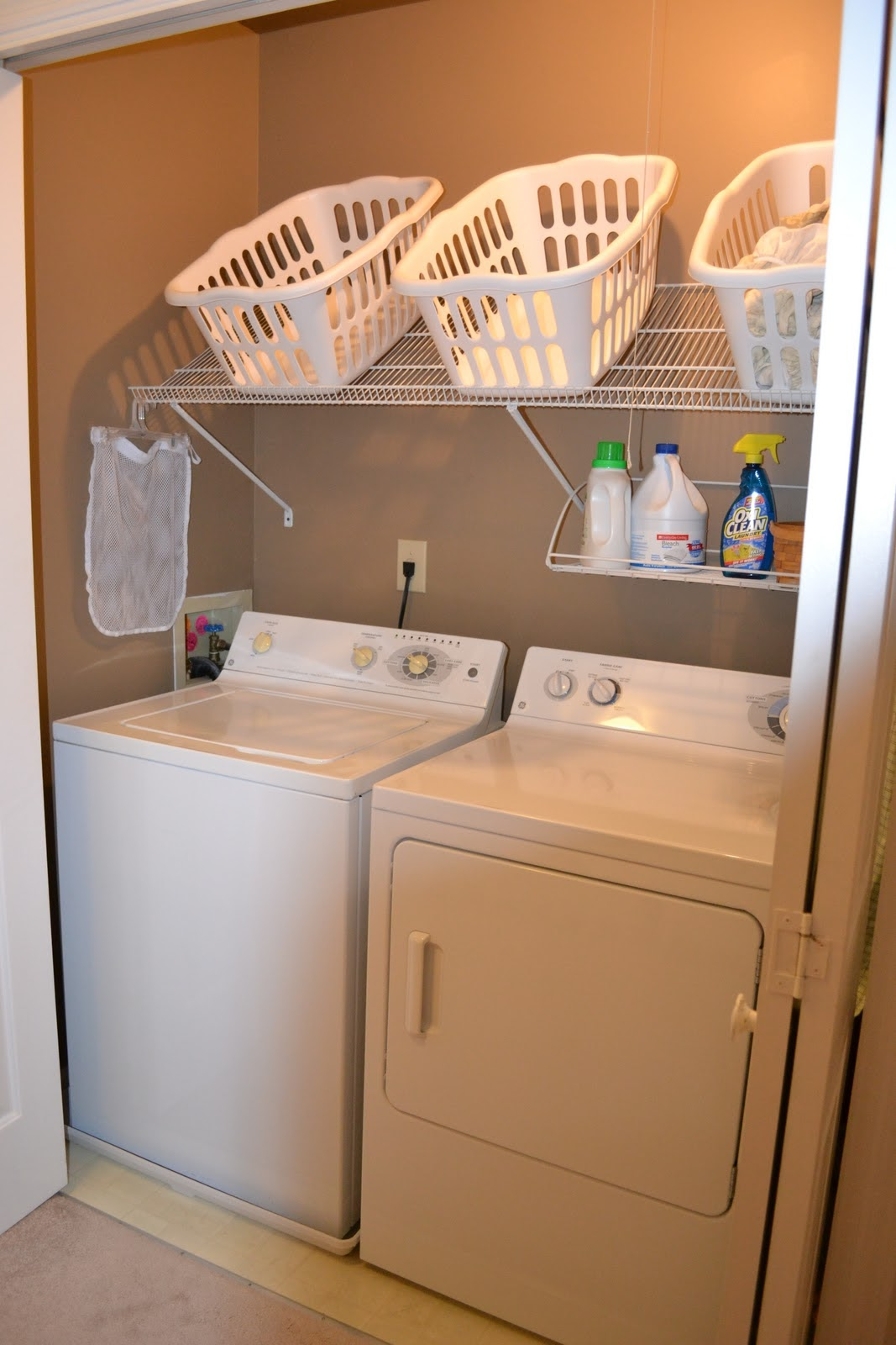 Laundry Closet With Cubbies And Cabinets