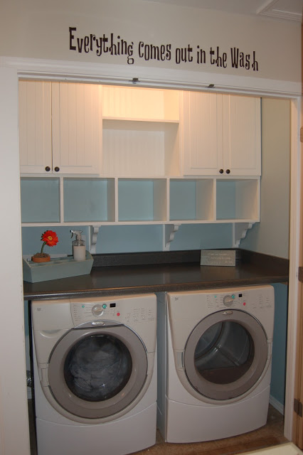 Small Laundry Closet With Built In Cubbies And Cabinets