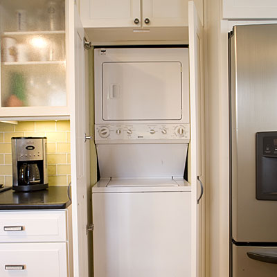 stacked washer and dryer in laundry closet in kitchen, Southern Living