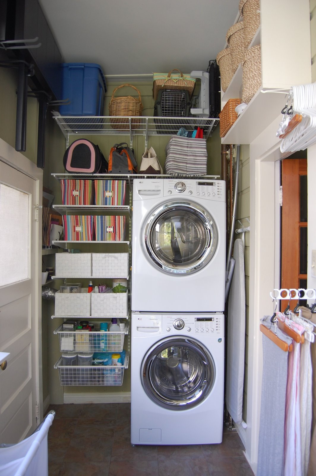 Tiny Organized Laundry Space With Stacked Washer And Dryer