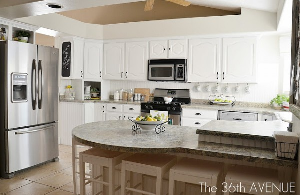 White kitchen remodel using thrifted cabinets remodelaholic for Kitchen remodel pics