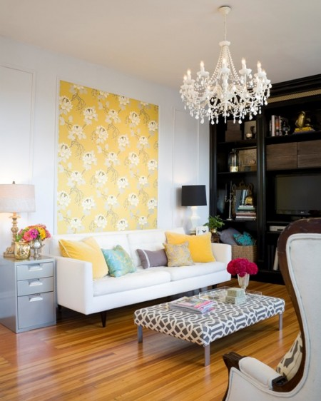 colorful casual living room with yellow patterned accent wall, Design Sponge