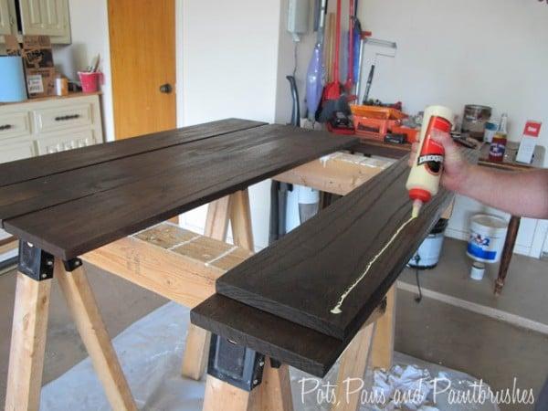 gluing the modern floating mantel shelf