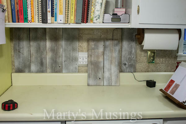 Use Primer To Adjust The Color Of Reclaimed Wood For Kitchen Backsplash