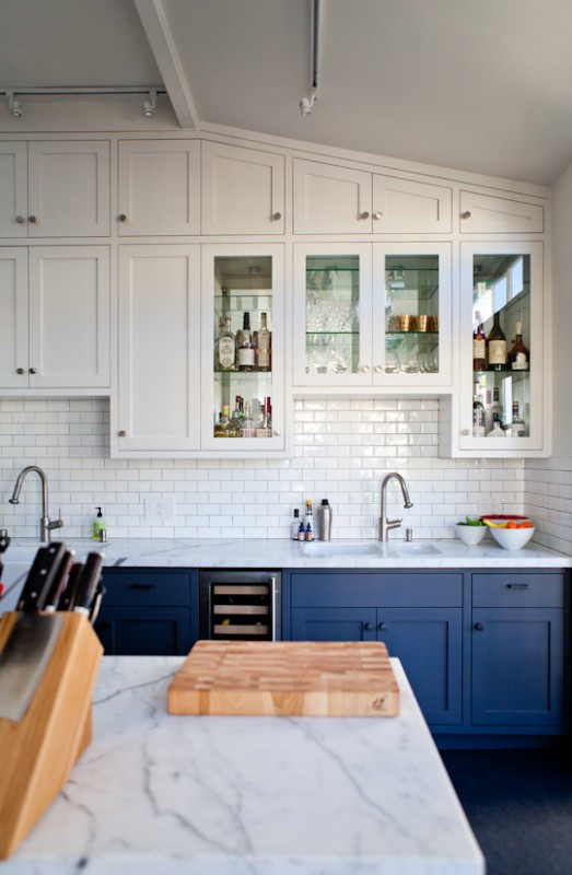 cabinets on kitchen islands or accent colored walls of cabinets are