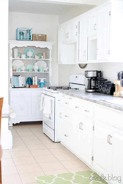 Charming White Kitchen Remodel Using Thrifted Cabinets