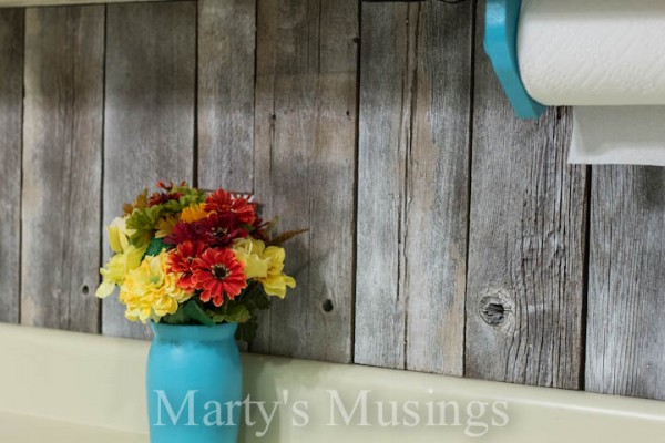 wood kitchen backsplash from reclaimed fence posts