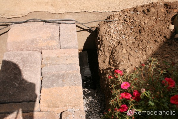 How to build a retaining wall with a drain pipe from Remodelaholic