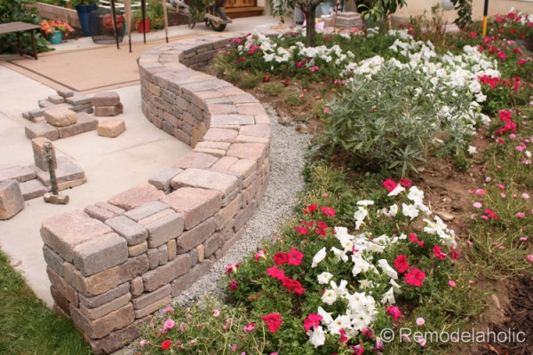 how to build a curved retaining wall using Rumblestone blocks, from Remodelaholic