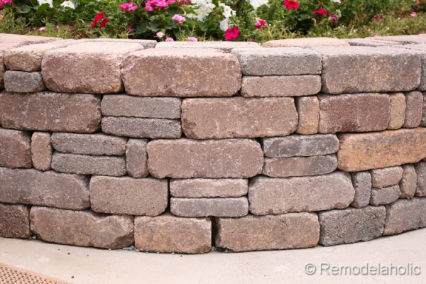 Beautiful retaining wall for a backyard garden, DIY tutorial from Remodelaholic