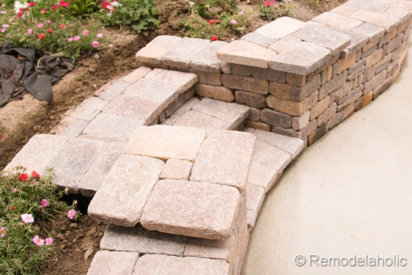 How to build a retaining wall with steps and platforms for flower pots, from Remodelaholic