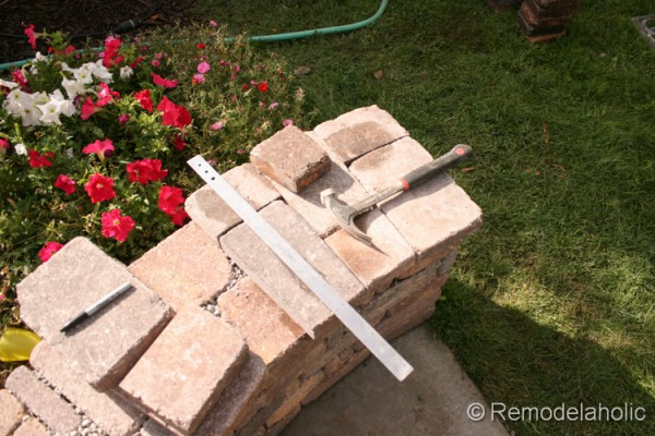 How to add a top to a DIY retaining wall, by Remodelaholic