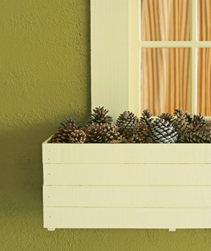 pine cones in window boxes for winter, RealSimple