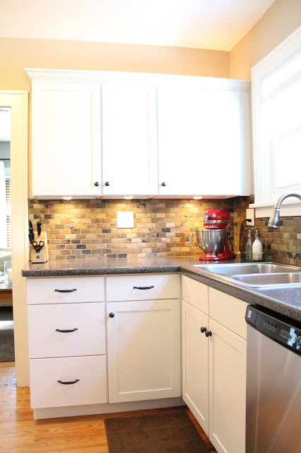 Small kitchen remodel featuring slate tile backsplash for Backsplash designs for small kitchen