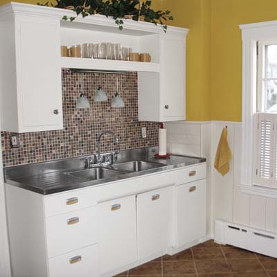 Small kitchen remodel featuring slate tile backsplash for Kitchen remodel ideas for older homes
