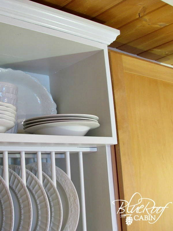 staggered shelves on the custom diy plate rack cabinet