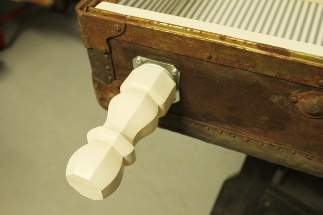 Add Leg Brackets For Antique Suitcase Bookshelf Makeover Featured On Remodelaholic