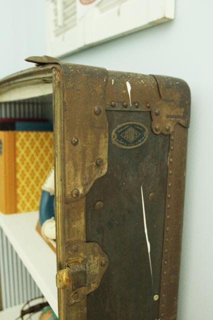 details of antique suitcase bookshelf, featured on Remodelaholic.com