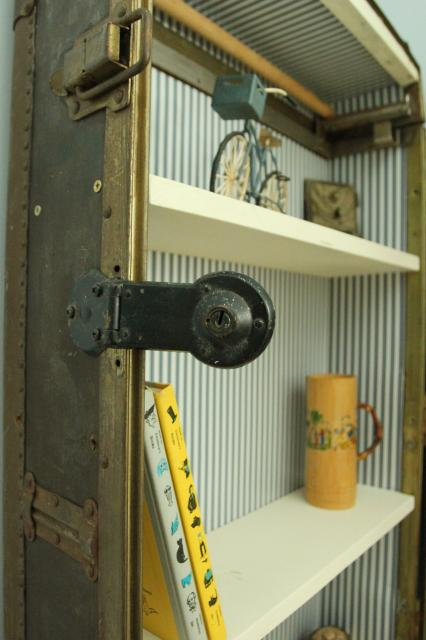 details of antique trunk bookshelf, featured on Remodelaholic.com