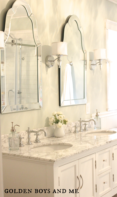 double vanity with two curvy mirrors, elegant master bath remodel featured on Remodelaholic.com