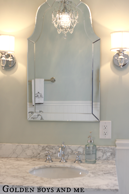 Gorgeous Shaped Mirror In An Elegant Master Bath Featured On Remodelaholic