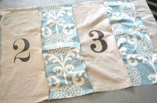 iron on numbers for a Land of Nod floor pouf copycat, featured on Remodelaholic.com