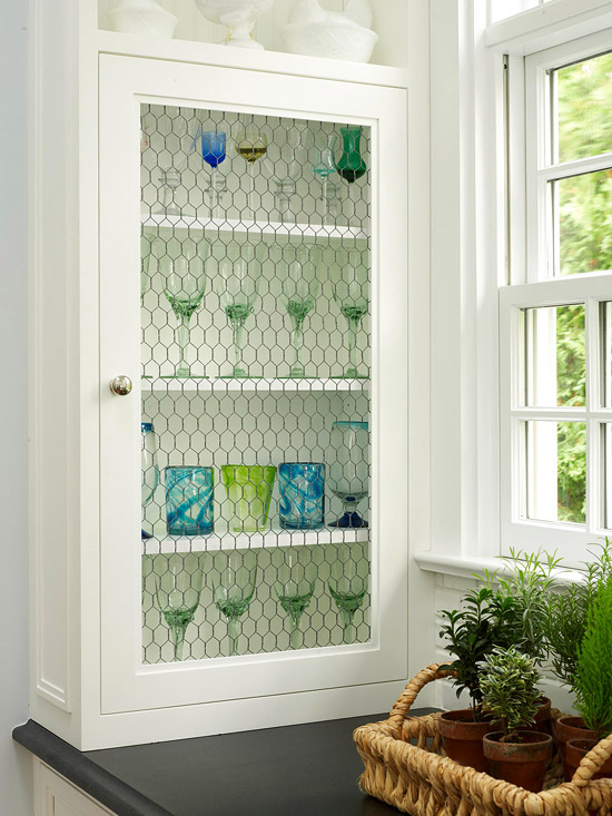 kitchen curio cabinet with chicken wire, Better Homes and Gardens - featured on Remodelaholic.com