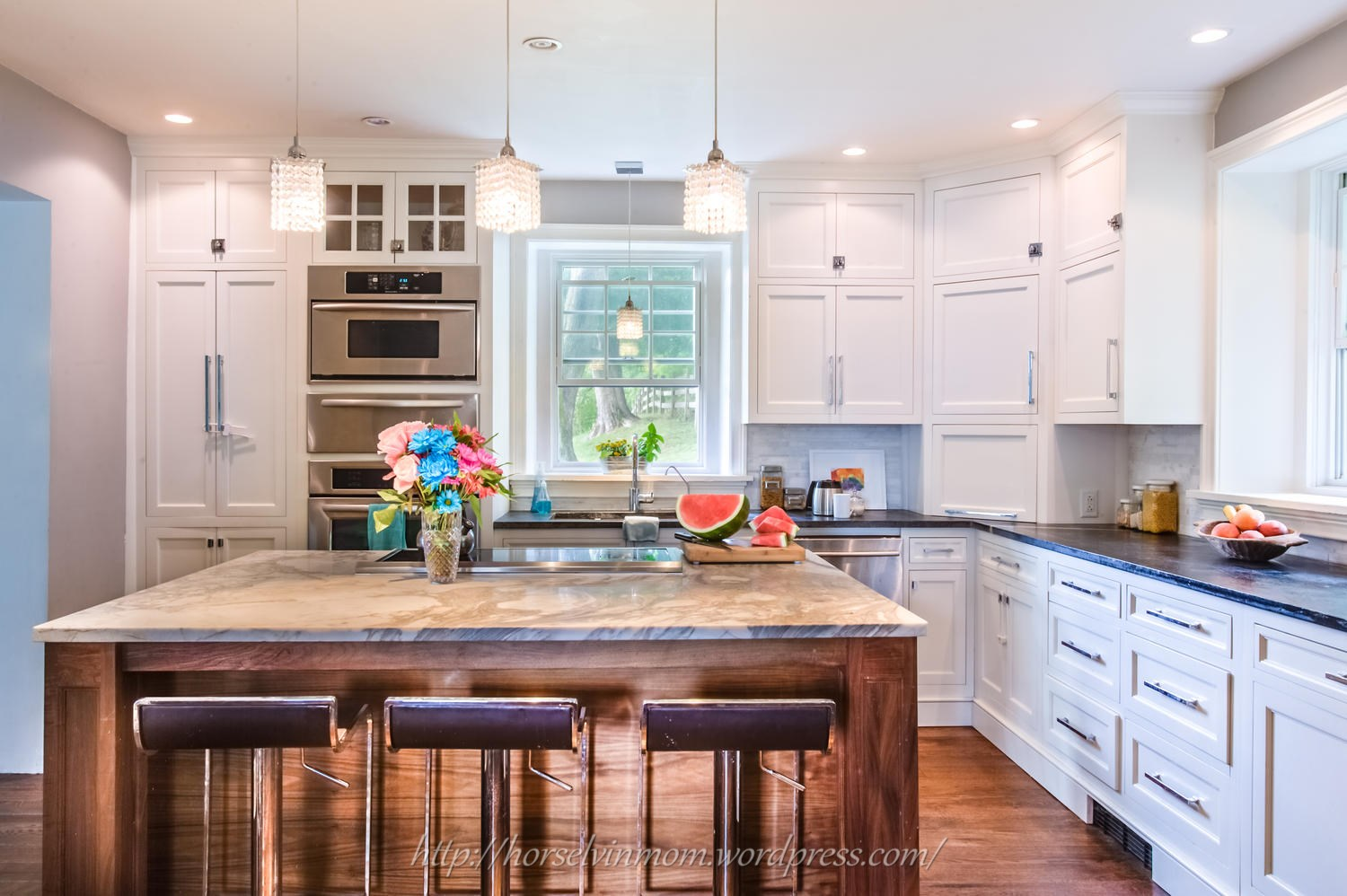 white country kitchen remodel with chrome barstools, featured at  Remodelaholic.com