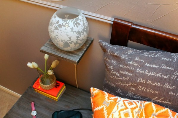 DIY bedside floating shelf with lamp, Turtles and Tails featured on Remodelaholic.com