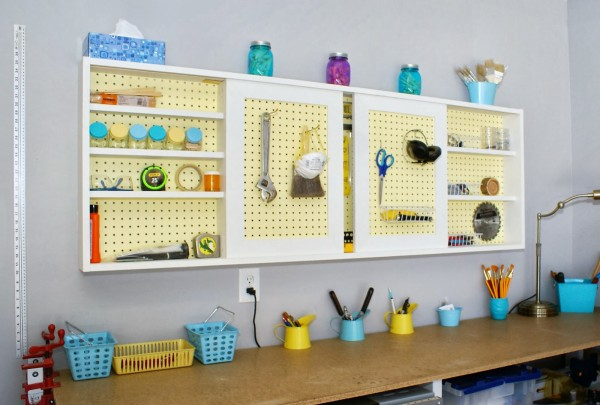 Remodelaholic build an organized pegboard tool cabinet and simple diy tutorial pegboard tool cabinet with sliding doors featured on remodelaholic publicscrutiny Images