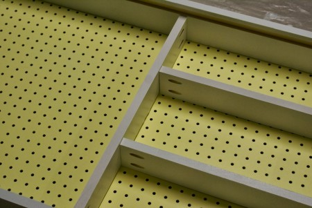adding shelves to the pegboard tool cabinet, featured on Remodelaholic.com